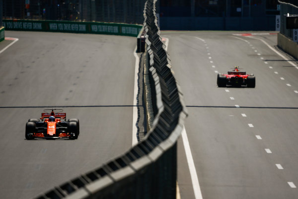 Baku City Circuit, Baku, Azerbaijan. Friday 23 June 2017. Fernando Alonso, McLaren MCL32 Honda, and Kimi Raikkonen, Ferrari SF70H. World Copyright: Andrew Hone/LAT Images ref: Digital Image _ONY8639