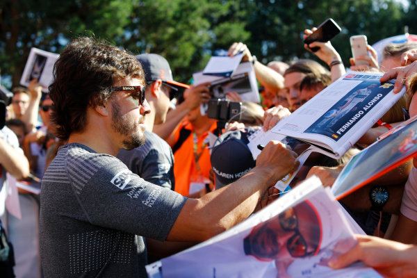 Red Bull Ring, Spielberg, Austria. Thursday 06 July 2017. Fernando Alonso, McLaren, signs autographs for fans. World Copyright: Steven Tee/LAT Images ref: Digital Image _O3I4506