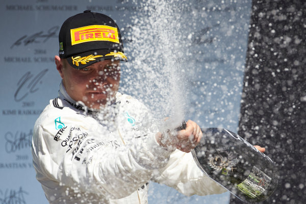 Interlagos, Sao Paulo, Brazil. Sunday 12 November 2017. Valtteri Bottas, Mercedes AMG, 2nd Position, sprays Champagne on the podium. World Copyright: Steve Etherington/LAT Images  ref: Digital Image SNE17477