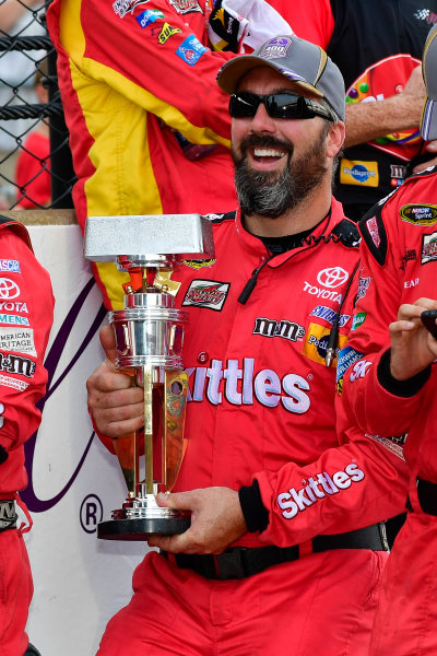 22-24 July, 2016, Indianapolis, Indiana USA Kyle Busch, Skittles Toyota Camry crew members pose with the trophy ?2016, Logan Whitton  LAT Photo USA