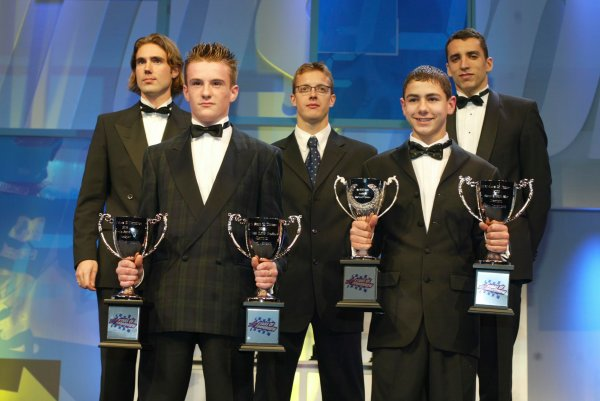 2003 AUTOSPORT AWARDS, The Grosvenor, London. 7th December 2003.Two young Karters receive awards with three F3000 Champions, Bjorn Wirdheim, Sebastien Bourdais and Justin Wilson.Photo: Peter Spinney/LAT PhotographicRef: Digital Image only