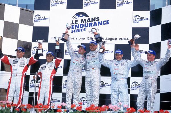 2004 Le Mans Endurance SeriesSilverstone 1000 KilometersSilverstone, England. 12th - 14th August 2004LMP1 Podium - Winners McNish/Kaffer (Veloqx Audi R8), 2nd placed Capello/Ara (Team Goh Audi R8) and 3rd placed Herbert/Davies (veloqx Audi R8).World Copyright: Glenn Dunbar/LAT Photographicref: 35mm Transparency A38