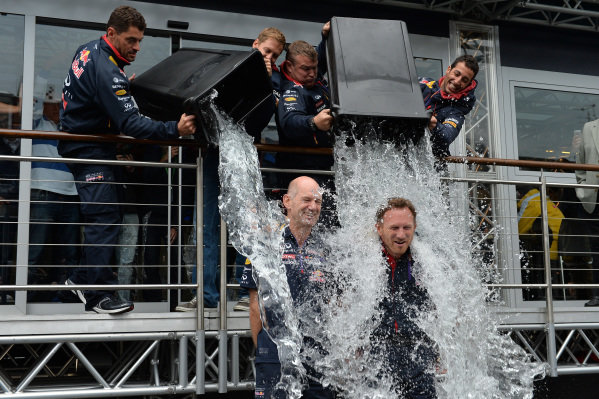 Adrian Newey (GBR) Red Bull Racing Chief Technical Officer and Christian Horner (GBR) Red Bull Racing Team Principal take the ice bucket challenge with Sebastian Vettel (GER) Red Bull Racing and Daniel Ricciardo (AUS) Red Bull Racing on water tipping duties. Formula One World Championship, Rd12, Belgian Grand Prix, Qualifying, Spa-Francorchamps, Belgium, Saturday 23 August 2014.  BEST IMAGE
