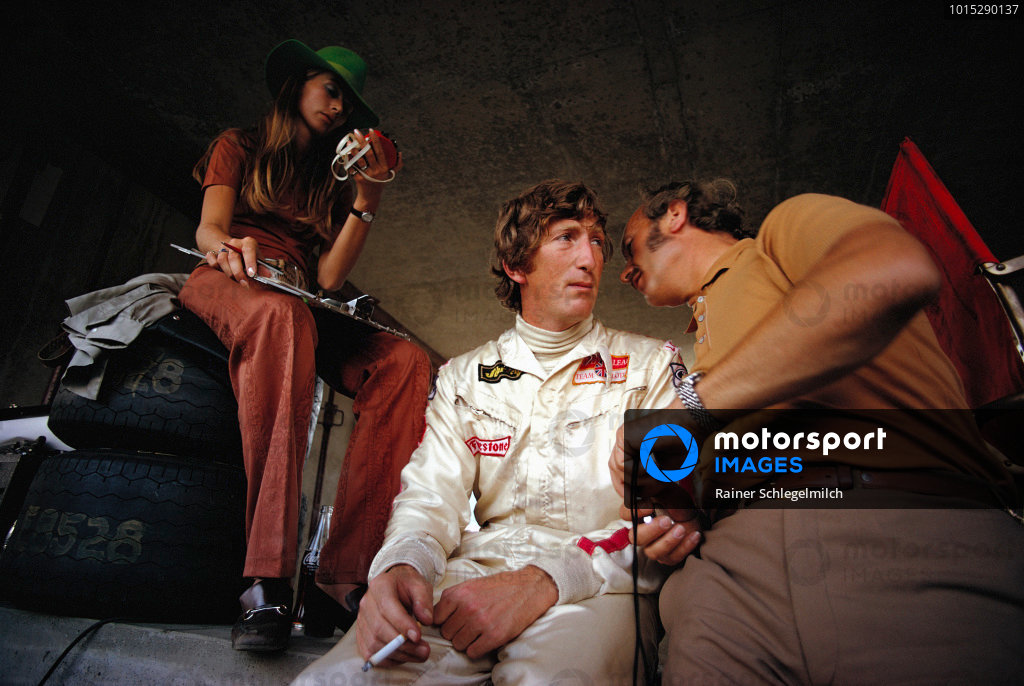 Jochen Rindt in pits with wife Nina and Lotus team boss Colin Chapman.