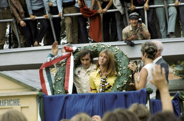 Jackie Stewart (GBR) Matra celebrates his victory and first World Championship title on the podium with his wife Helen.