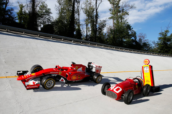 Autodromo Nazionale di Monza, Monza, Italy. Saturday 5 September 2015. A Ferrari SF-15T and a Ferrari 166 F2 car on the Monza banking. World Copyright: Glenn Dunbar/LAT Photographic ref: Digital Image _W2Q0676