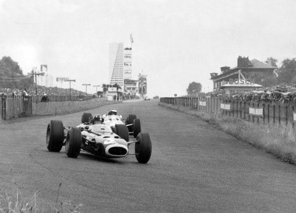 1966 German Grand Prix.Nurburgring, Germany. 7 August 1966.Graham Hill, BRM P261, 4th position, leads Jim Clark, Lotus 33-Climax, retired, action.World Copyright: LAT PhotographicRef: Autosport b&w print