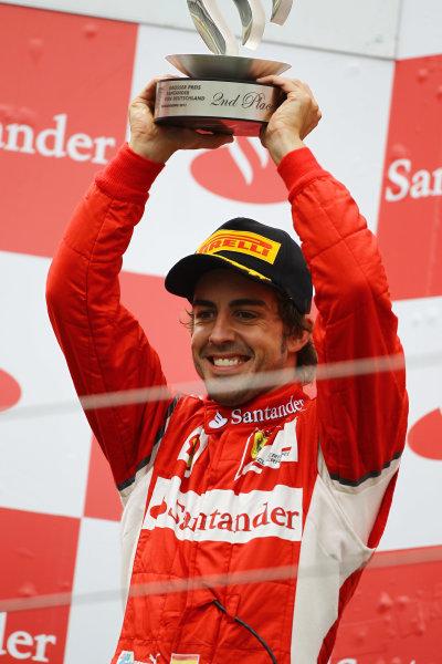 Nurburgring, Germany.24th July 2011Fernando Alonso, Ferrari 150° Italia, 2nd position, lifts his trophy. Portrait. Podium. World Copyright: Andy Hone/LAT Photographicref: Digital Image CSP13465