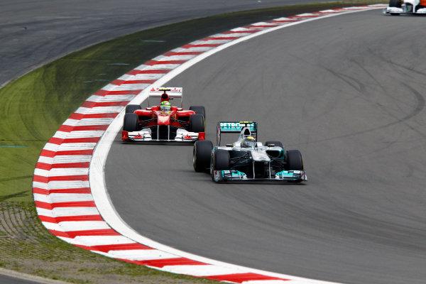 Nurburgring, Germany24th July 2011Nico Rosberg, Mercedes GP W02, 7th position, leads Felipe Massa, Ferrari 150° Italia, 5th position. Action. World Copyright: Charles Coates/LAT Photographicref: Digital Image _D1E3627