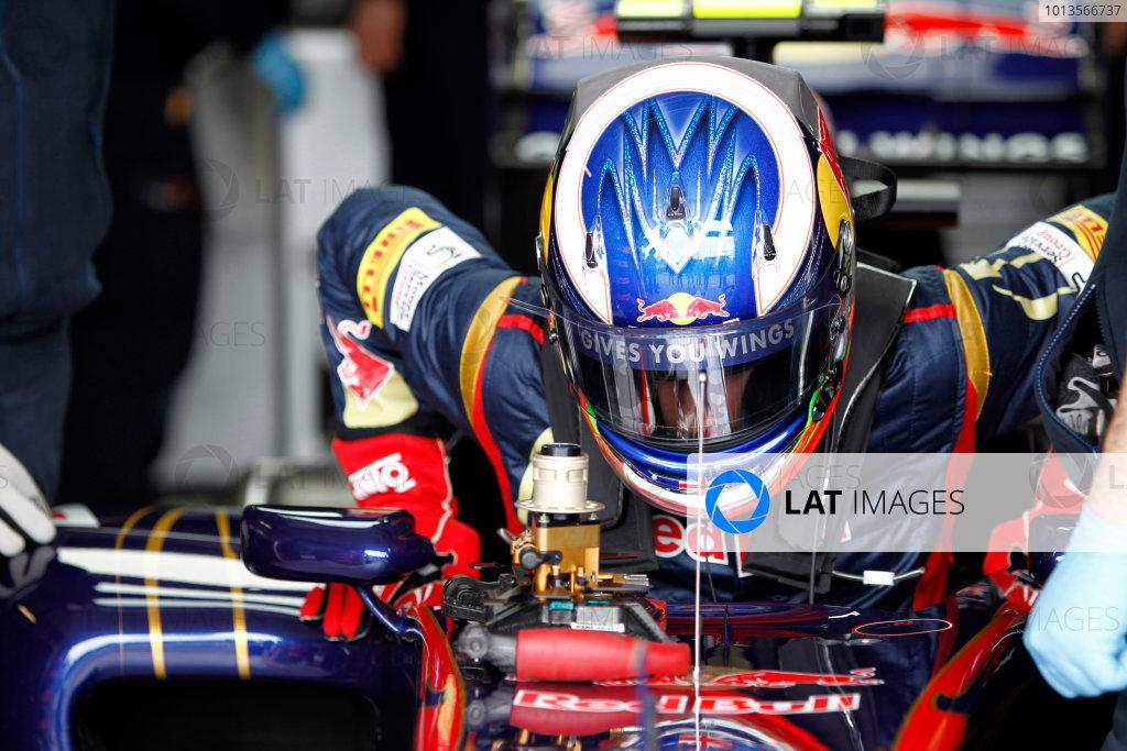 Albert Park, Melbourne, Australia 25th March 2011. Daniel Ricciardo, Toro Rosso STR6, lowers himself into the drivers seat. Portrait. Helmets.  World Copyright: Andrew Ferraro/LAT Photographic ref: Digital Image