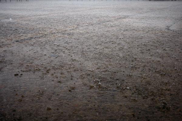 Sepang, Kuala Lumpur, Malaysia2nd April 2009A monsoon storm striks the paddock, as rain drops bounce from huge puddles.World Copyright: Lorenzo Bellanca/LAT Photographicref: Digital Image _64I2201