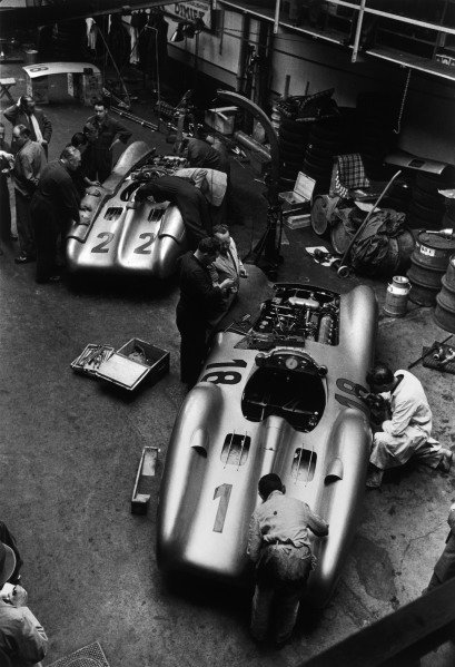 Reims, France. 4th July 1954.The cars of Hans Herrmann, Mercedes-Benz W196 #22, retired, and Juan Manuel Fangio, Mercedes-Benz W196 #18, 1st position, being worked on in the paddock, garage.World Copyright: LAT PhotographicRef: Autosport B&W print. Published: Autosport, 16/7/1954 p82