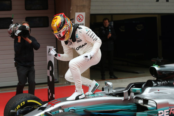 Shanghai International Circuit, Shanghai, China.  Sunday 09 April 2017.  Lewis Hamilton, Mercedes AMG, 1st Position, celebrates on arrival in Parc Ferme on the nose of his car. World Copyright: Charles Coates/LAT Images  ref: Digital Image AN7T0751