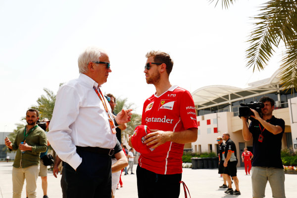 Bahrain International Circuit, Sakhir, Bahrain.  Thursday 13 April 2017. Sebastian Vettel, Ferrari, talks with Charlie Whiting, Race Director, FIA, in the paddock. World Copyright: Sam Bloxham/LAT Images ref: Digital Image _J6I8340