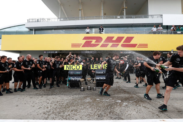 Suzuka Circuit, Japan. Sunday 9 October 2016. The Mercedes AMG team celebrate securing their 3rd consecutive constructors title. World Copyright: Dunbar/LAT Photographic ref: Digital Image _X4I8669