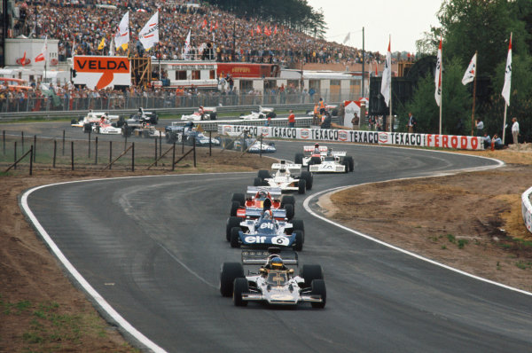 1973 Belgian Grand Prix.  Zolder, Belgium. 18-20th May 1973.  Ronnie Peterson, Lotus 72E Ford, leads out of the Kleine Chicane at the start from François Cevert, Tyrrell 006 Ford, Jacky Ickx, Ferrari 312B3, and Denny Hulme, McLaren M23 Ford.  Ref: 73BEL71. World Copyright: LAT Photographic