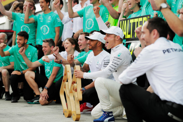 Red Bull Ring, Spielberg, Austria. Sunday 09 July 2017. Valtteri Bottas, Mercedes AMG, celebrates his victory with his team and Lewis Hamilton, Mercedes AMG.  World Copyright: Zak Mauger/LAT Images ref: Digital Image _54I1632