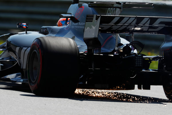 Red Bull Ring, Spielberg, Austria. Friday 07 July 2017. Romain Grosjean, Haas VF-17, strikes sparks as he drives back to the pits in FP1 with a front left puncture. World Copyright: Glenn Dunbar/LAT Images ref: Digital Image _X4I4541