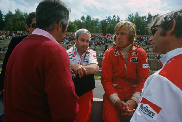 Zolder, Belgium. 14th - 16th May 1976. James Hunt (McLaren M23-Ford), retired, in conversation with Teddy Mayer and Roger Penske on the pit wall, portrait. World Copyright: LAT Photographic.  Ref: 76 BEL 35.