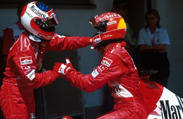 Rubens Barrichello (BRA), Ferrari 2nd place congratulates race winner Michael Schumacher (GER). The two switched places approaching the finish line to enhance Schumacher's championship standing. Austrian Grand Prix, A1-Ring, Austria, 12 May 2002 BEST IMAGE