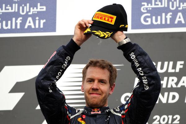 Bahrain International Circuit, Sakhir, Bahrain22nd April 2012Sebastian Vettel, Red Bull Racing, 1st position, celebrates on the podium.World Copyright: Andy Hone/LAT Photographicref: Digital Image HONY8642