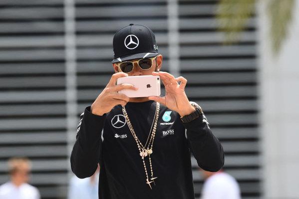 Lewis Hamilton (GBR) Mercedes AMG F1 with phone at Formula One World Championship, Rd2, Bahrain Grand Prix Practice, Bahrain International Circuit, Sakhir, Bahrain, Friday 1 April 2016.