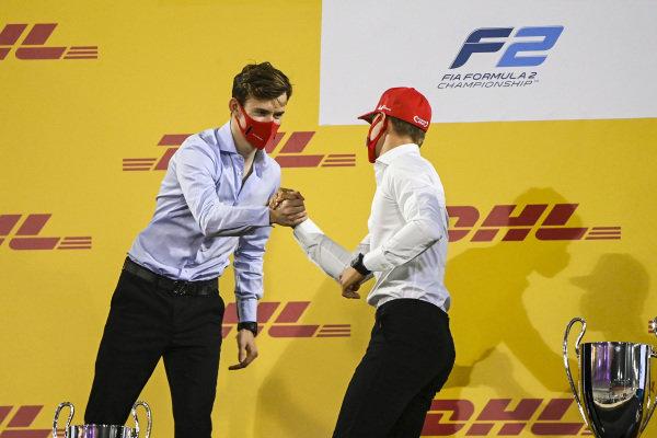 F2 Championship 2nd position Callum Ilott (GBR, UNI-VIRTUOSI) and 1st position Mick Schumacher (DEU, PREMA RACING) celebrate on the podium