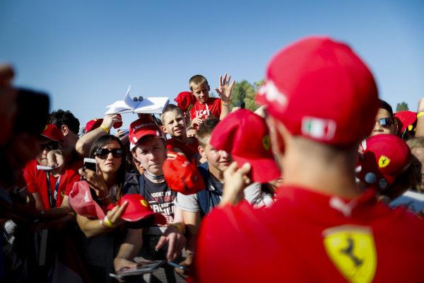 Sebastian Vettel, Ferrari signs an autograph for a fan