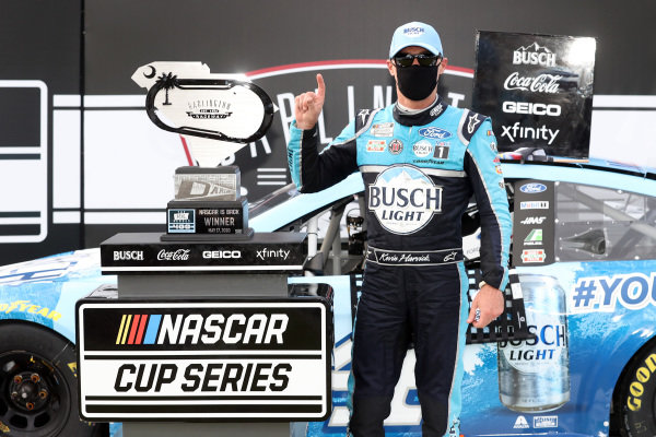 Race winner Kevin Harvick, Stewart-Haas Racing Ford Busch Light YOURFACEHERE Copyright: Chris Graythen/Getty Images.