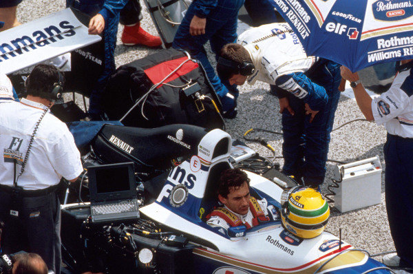 Ayrton Senna, Williams FW16 Renault, on the grid. Engineers prepare his car.
