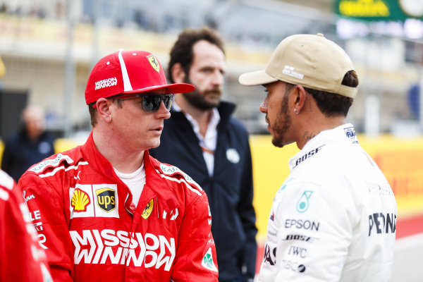 Kimi Raikkonen, Ferrari, speaks to pole man Lewis Hamilton, Mercedes AMG F1, after Qualifying