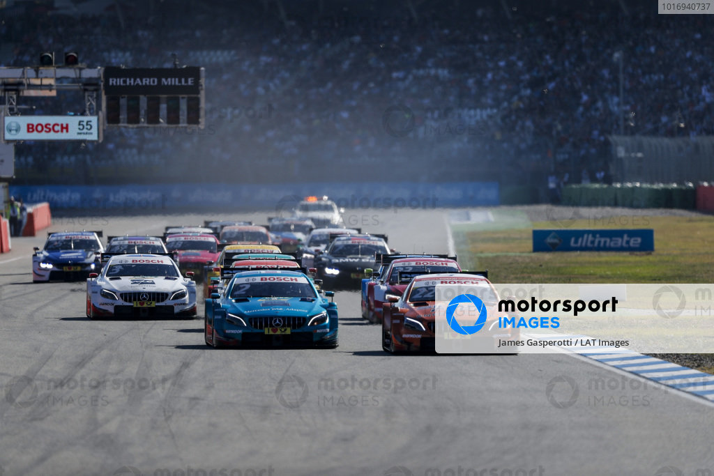Lucas Auer, Mercedes-AMG Team HWA, Mercedes-AMG C63 DTM leads at the start of the race.