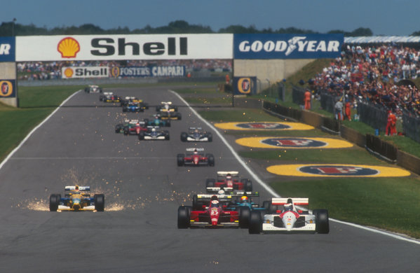 1991 British Grand Prix.Silverstone, England.12-14 July 1991.Gerhard Berger (McLaren MP4/6 Honda) on the approach to Stowe at the start, with Alain Prost (Ferrari 643), Mauricio Gugelmin (Leyton House CG911 Ilmor), Stefano Modena (Tyrrell 020 Honda) and a super sparking Nelson Piquet (Benetton B191 Ford) following behind down Hangar Straight.Ref-91 GB 10.World Copyright - LAT Photographic