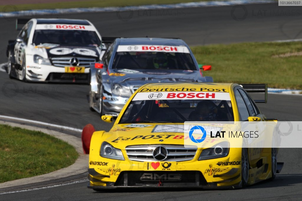 David Coulthard (GBR), Deutsche Post AMG Mercedes C-Klasse (2008) ahead of Jamie Green (GBR), AMG Mercedes C-Klasse (2009) and Maro Engel (GER), GQ AMG Mercedes C-Klasse (2008).DTM, Rd8, Oschersleben, Germany, 16-18 September 2011 Ref: Digital Image dne1117se574