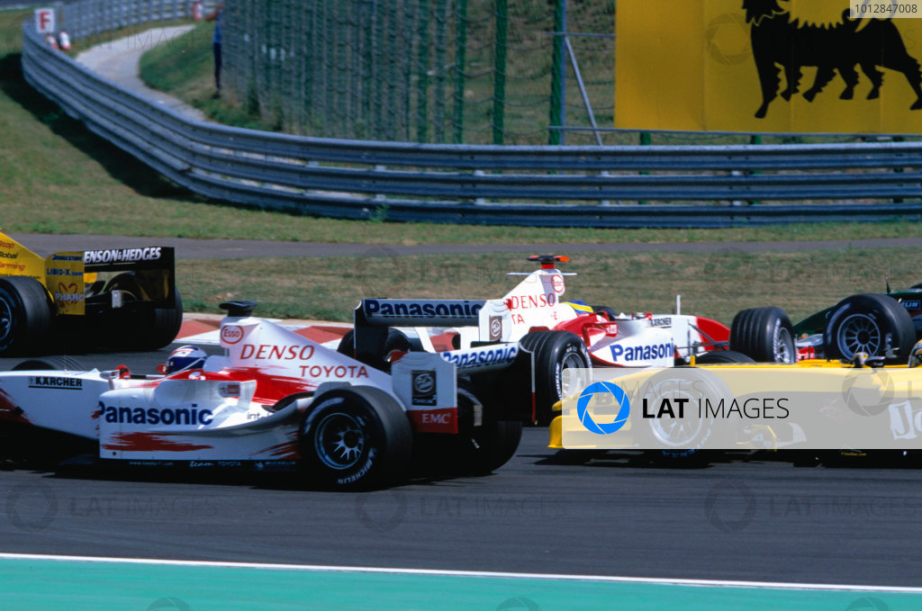 2004 Hungarian Grand Prix Hungaroring, Hungary. 13th - 15th August. Ricardo Zonta, Toyota TF104 spins on the opening lap. Action. World Copyright:Charles Coates/LAT Photographic Ref:35mm Image:A03