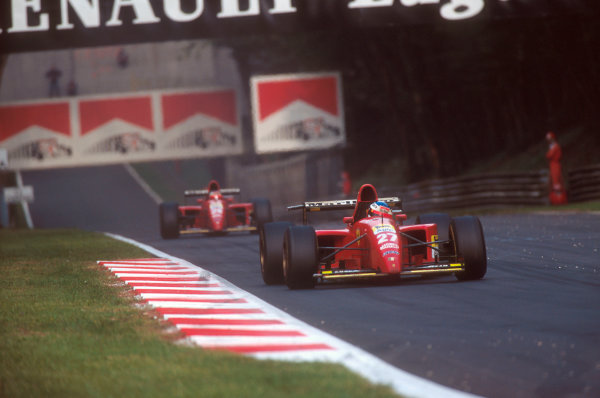 Monza, Italy.8-10 September 1995.Jean Alesi (Ferrari 412T2). He exited the race after his rear wheel bearing failed. Note how the rear wing camera on his car is at a strange angle. It was to eventually fall off, straight into the rear suspension of teammate Gerhard Berger's car (who runs behind him here) at speed, causing his retirement as well. Ref-95 ITA 03.World Copyright - LAT Photographic