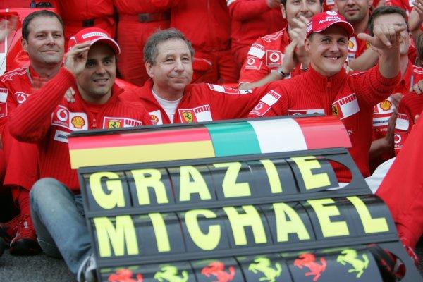 2006 Brazilian Grand Prix - Sunday Race Interlagos, Sao Paulo, Brazil. 19th - 22nd October 2006. The Ferrari team say goodbye to Michael Schumacher after the 7 times World Champion retires, portrait. World Copyright: Lorenzo Bellanca/LAT Photographic ref: Digital Image MU4Z4383