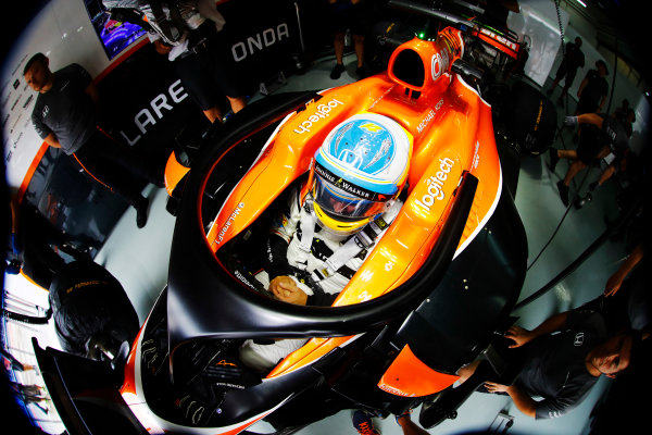 Sepang International Circuit, Sepang, Malaysia. Friday 29 September 2017. Fernando Alonso, McLaren, waits in cockpit in the team's garage during FP1. The halo device is fitted to his car. World Copyright: Steven Tee/LAT Images  ref: Digital Image _R3I2884