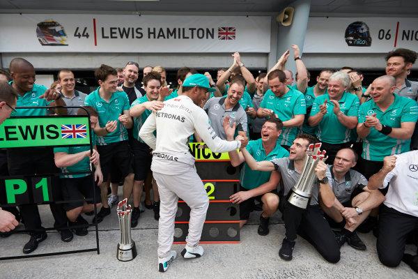 Sepang International Circuit, Sepang, Kuala Lumpur, Malaysia. Sunday 30 March 2014. Lewis Hamilton, Mercedes AMG, 1st Position, celebrates with his team. World Copyright: Steve Etherington/LAT Photographic. ref: Digital Image SNE10950 copy