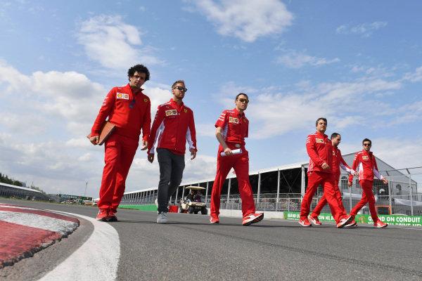 Sebastian Vettel (GER) Ferrari walks the track