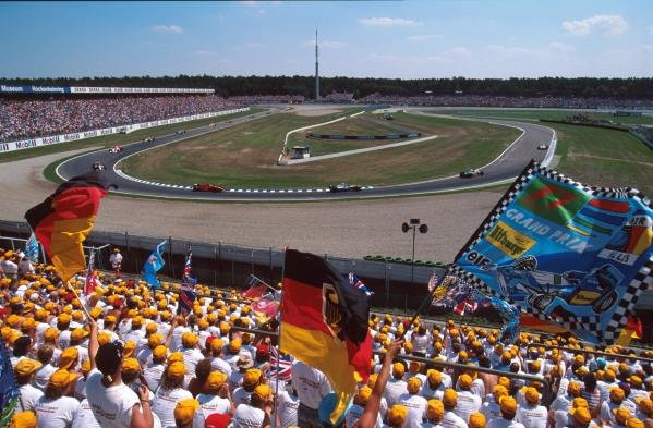 The huge crowd in the Hockenheim stadium cheer on the drivers. German GP, Hockenheim, 30 July 1995