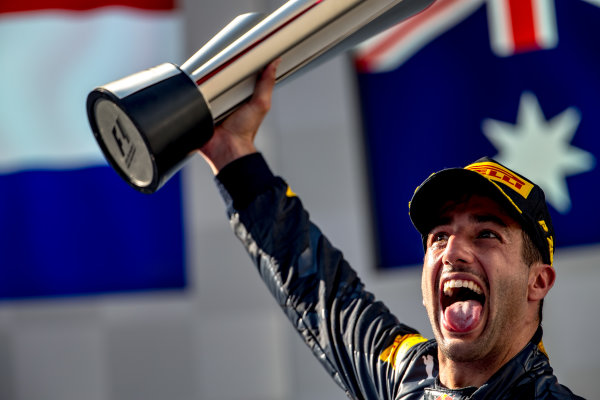 Sepang International Circuit, Sepang, Malaysia. Sunday 2 October 2016. Daniel Ricciardo, Red Bull Racing, 1st Position, celebrates victory on the podium with his trophy. World Copyright: Zak Mauger/LAT Photographic ref: Digital Image _X0W0323