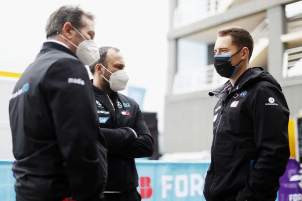A Mercedes Benz EQ team member with Gary Paffett, Reserve and Development Driver and Sporting and Technical Advisor, Mercedes Benz EQ, and Stoffel Vandoorne (BEL), Mercedes Benz EQ