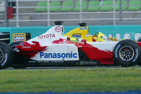 2003 Malaysian Grand Prix. Sepang, Kuala Lumpur, Malaysia.21-23 March 2003.Cristiano da Matta (Toyota TF103) and Ralph Firman (Jordan EJ13 Ford) on the grid before the start.World Copyright - LAT Photographic ref: Digital Image Only