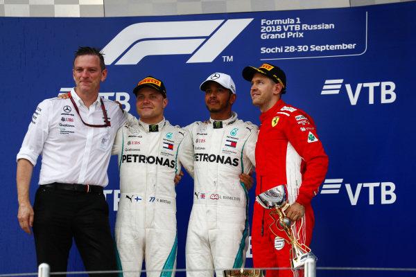 James Allison, Technical Director, Mercedes AMG, Valtteri Bottas, Mercedes AMG F1, 2nd position, Lewis Hamilton, Mercedes AMG F1, 1st position, and Sebastian Vettel, Ferrari, 3rd position, on the podium