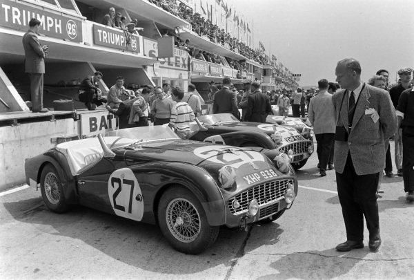 Ninian Sanderson / Claude Dubois' Standard Triumph, Triumph TR3 S, in the pits, next to Peter Bolton / Michael Rotschild's Standard Triumph, Triumph TR 3S.