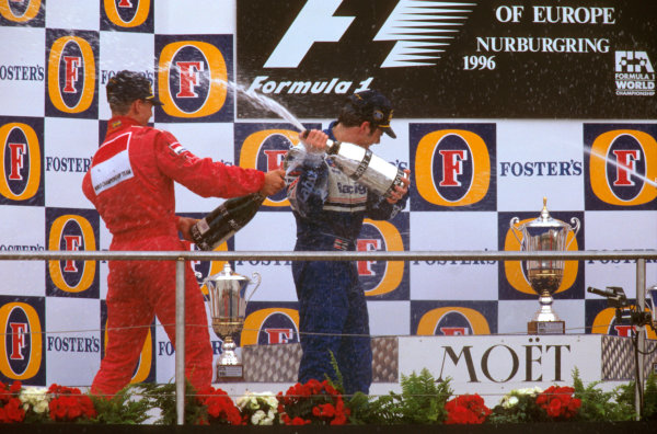 Nurburgring, Germany.26-28 April 1996.Jacques Villeneuve (Williams Renault) 1st position gets sprayed by Michael Schumacher (Ferrari) 2nd position on the podium. Ref-96 EUR 09.World Copyright - LAT Photographic