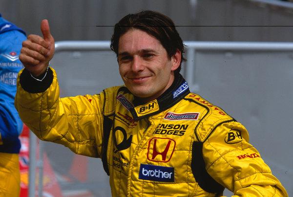 2002 Austrian Grand Prix.A1-Ring, Zeltweg, Austria.10-12 May 2002.Giancarlo Fisichella (Jordan Honda) celebrates his 5th position in parc ferme.Ref-02 AUT 36.World Copyright - LAT Photographic