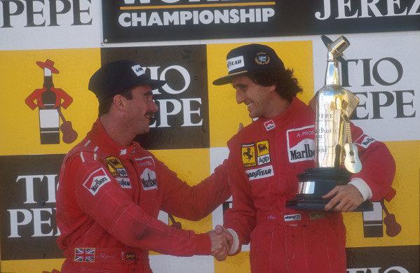 1990 Spanish Grand Prix.Jerez, Spain.28-30 September 1990.Alain Prost, 1st position celebrates on the podium with teammate Nigel Mansell, 2nd position (both Ferrari).Ref-90 ESP 04.World Copyright - LAT Photographic