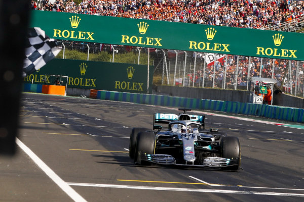 Race winner Lewis Hamilton, Mercedes AMG F1 W10 crosses the finish line with the checkered flag being waved by Simon Pagenaud